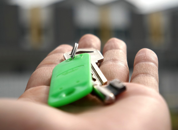 An image showing someone holding house keys in their hand